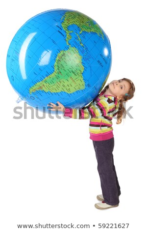 Young girl looking at inflatable globe Stock photo © IS2