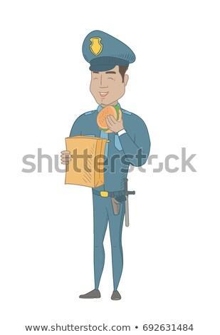 Genç koyu esmer polis memuru yeme hamburger Stok fotoğraf © RAStudio