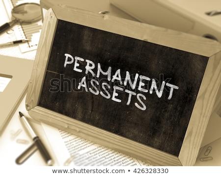 permanent assets on chalkboard in the office stock photo © tashatuvango