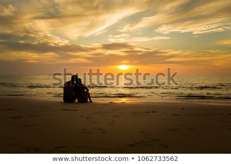 Young couple watching the sunset  Stock photo © stefanoventuri