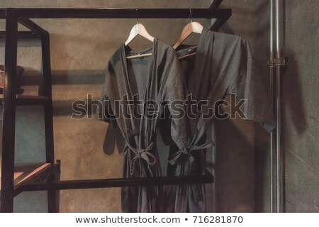 a black bathrobe is hanging at the wardrobe Stock photo © magann