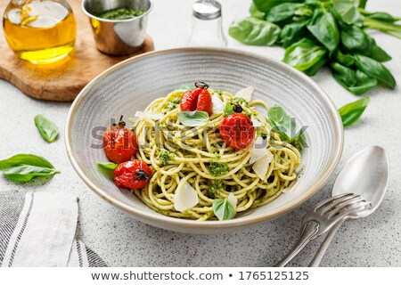 bowl of pasta with homemade pesto stock photo © mpessaris