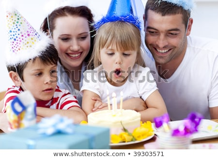 couple and young son with birthday cake stock photo © is2