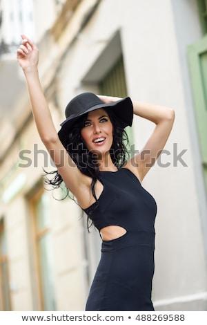 Portrait of a pretty seductive girl in black dress Stock photo © deandrobot