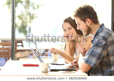 A boy helping his friend with schoolwork Stock photo © IS2