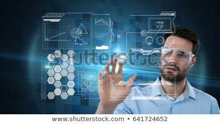 Homem óculos de proteção tocar invisível objeto Foto stock © wavebreak_media