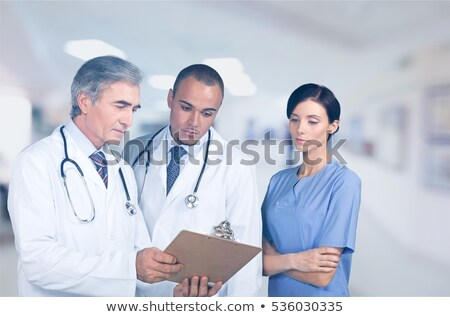 Three doctors in discussion Stock photo © IS2