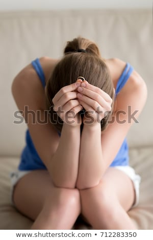 Upset Woman Holding Wedding Ring Stock photo © AndreyPopov