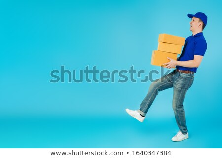 Smiling Male Mover Holding Package Stock photo © AndreyPopov