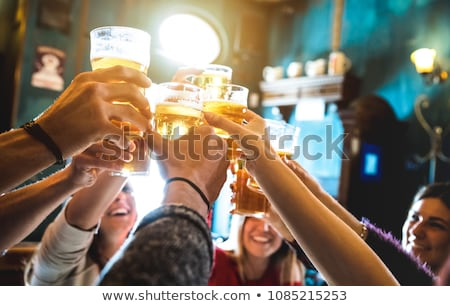 group of happy friends Stock photo © dolgachov