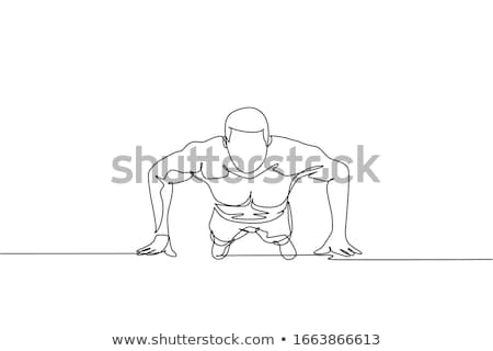 Young man practicing push-ups on one hand in the gym Stock photo © boggy