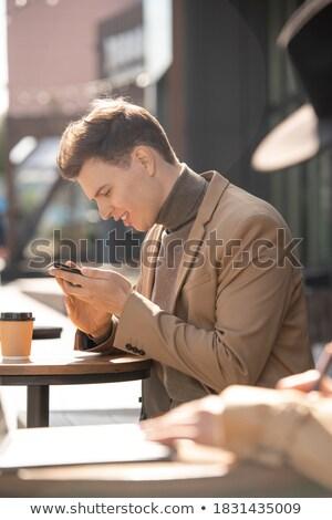 handsome man having coffee break in city looks to side Stock photo © feedough