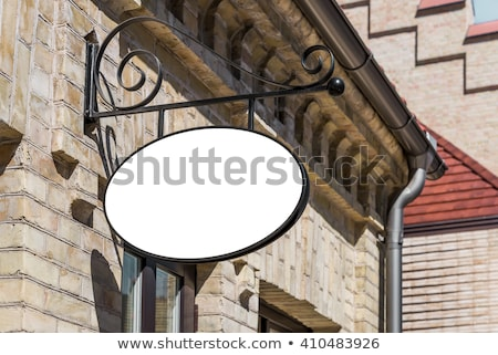 Empty oval sign on the old brick wall Stock photo © boggy