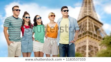 happy friends hugging over eiffel tower background Stock photo © dolgachov