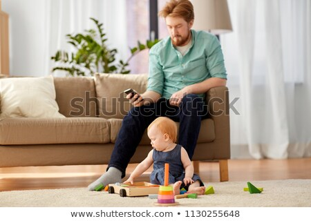 redhead baby girl playing with toy blocks at home Stock photo © dolgachov