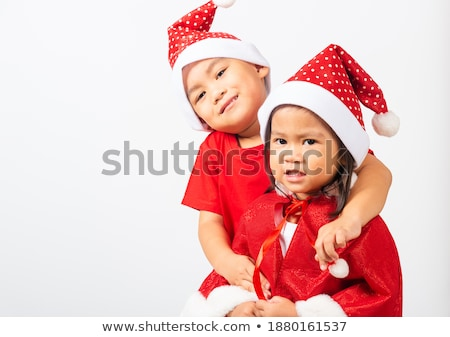 Two happy girls dressed in red hats Stock photo © deandrobot