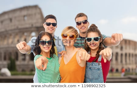 happy friends pointing at you over coliseum Stock photo © dolgachov