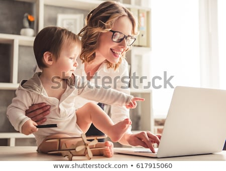 working mother with baby boy and laptop at home stock photo © dolgachov