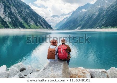 couple of travelers with backpacks hiking Stock photo © dolgachov