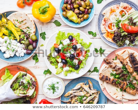 Tzatziki sauce, souvlaki and traditional greek dishes Stock photo © furmanphoto