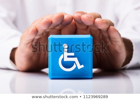 Person Protecting Cubic Block With Disabled Icon Stock photo © AndreyPopov