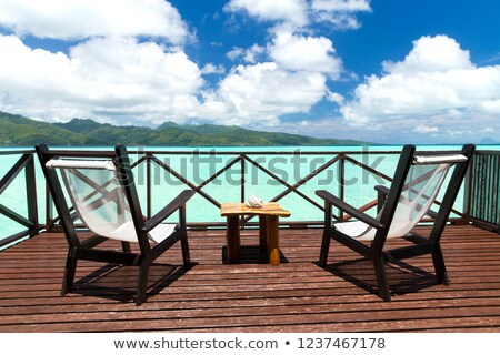 two chaise longues on terrace in french polynesia Stock photo © dolgachov