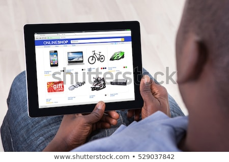 Business man holding a tablet with sale text Stock photo © wavebreak_media