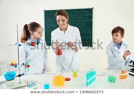 Pupils at School Lesson, Teacher Chemistry Flasks Stock photo © robuart