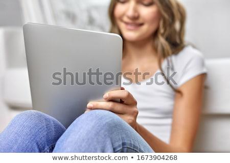 Fiatal lány kanapé tabletta lány gyermek modell Stock fotó © Lopolo
