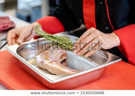 Chef putting seasoning on a lamb steak Stock photo © Kzenon