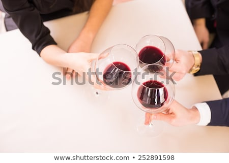 portrait of young beautiful lady holding glasses of wine Stock photo © Margolana