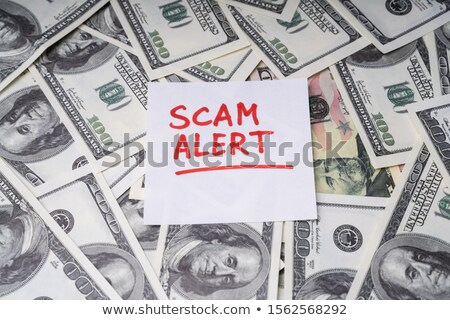 Background Of Dollar Bills With Scam Alert Text On Notepaper Stock photo © AndreyPopov
