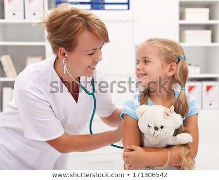 Happy little girl at the doctor for a checkup - being examined w Stock photo © Lopolo