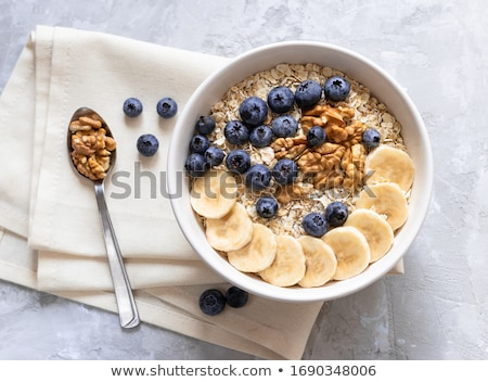 White bowl with natural organic granola cereal Stock photo © DenisMArt