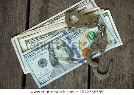 One hundred dollar banknote in handcuffs Stock photo © nomadsoul1