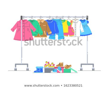 Kids clothes and shoes on hanger rack for donation Stock photo © vectorikart