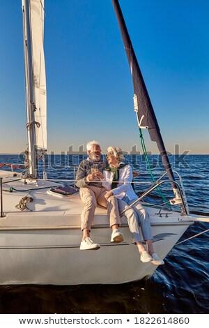 Family wedding couple on a sea voyage on a sailing yacht Stock photo © ElenaBatkova