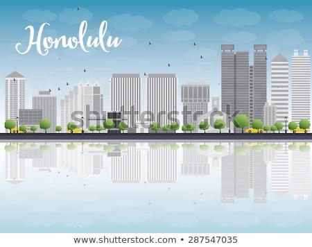 Honolulu Hawaii skyline with grey buildings and blue sky Stock photo © ShustrikS