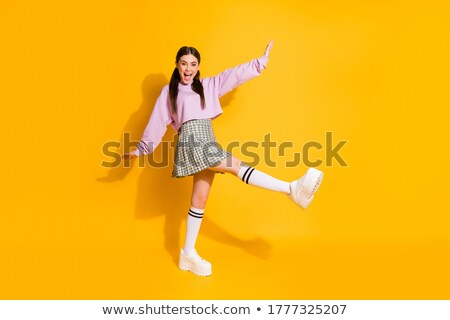Image of girls wearing pink clothes rejoicing and screaming toge Stock photo © deandrobot