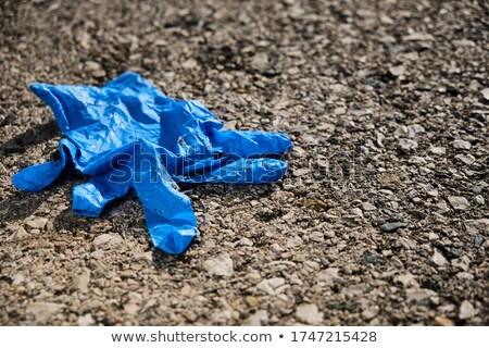 Usado látex luva asfalto azul Foto stock © nito