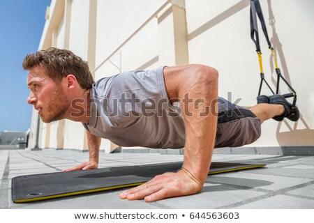Fitness man schorsing centrum atleet Stockfoto © Maridav
