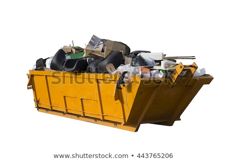 A skip full of building materials rubbish isolated on white. Stock photo © latent