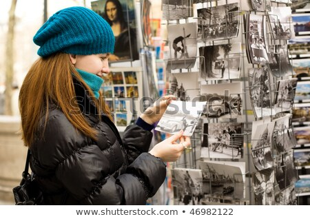 Couple choosing a postcard Stock photo © photography33
