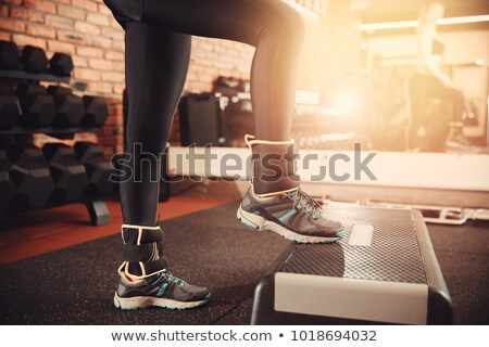 Woman working out with ankle weights Stock photo © photography33