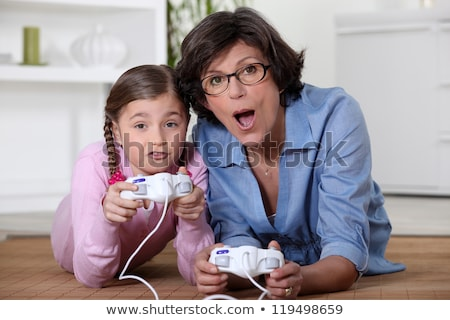 mother playing vide games with daughter stock photo © photography33