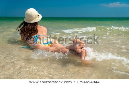 Donna bikini mare spiaggia cielo ragazza Foto d'archivio © photography33