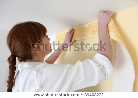 Woman gluing wallpaper border Stock photo © photography33