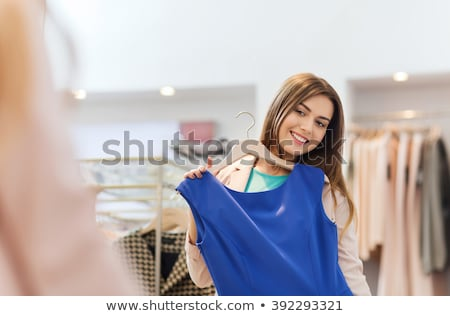 woman trying clothes dress stock photo © ariwasabi