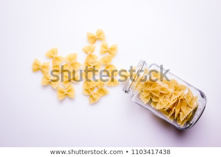 dried pasta spilling from jar stock photo © photography33
