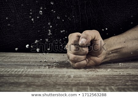 Male with fists on the table Stock photo © photography33